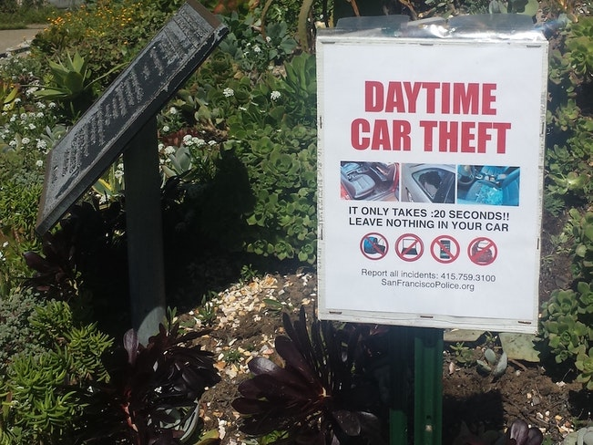 Daytime car theft sign