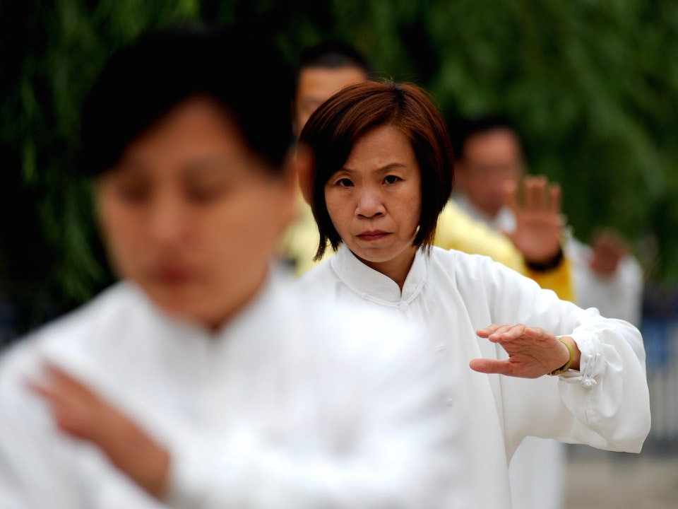 Woman doing tai chi by edwin lee.jpg?ixlib=rails 0.3