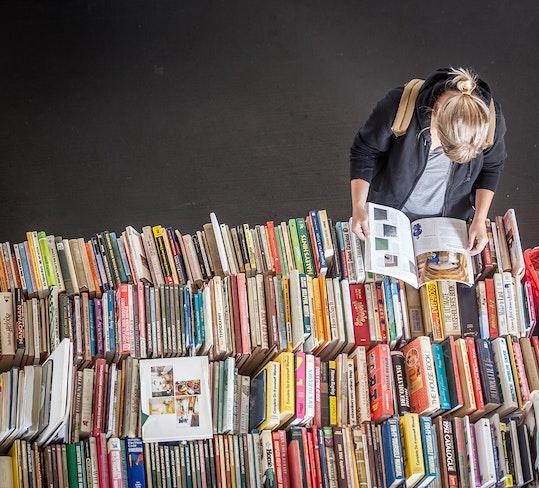 Big book sale woman row of books web