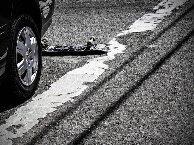 Skateboard under car