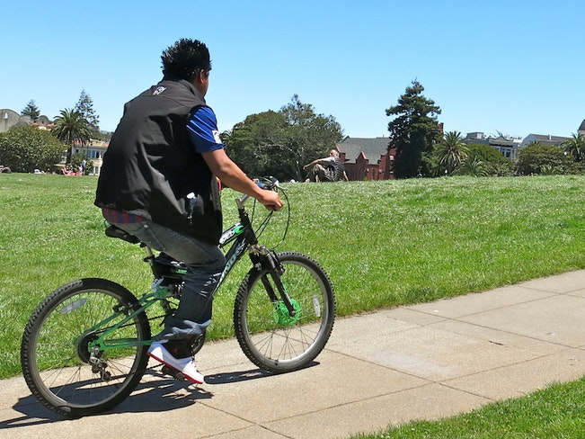 Dolores park bicyclist by torbakhopper
