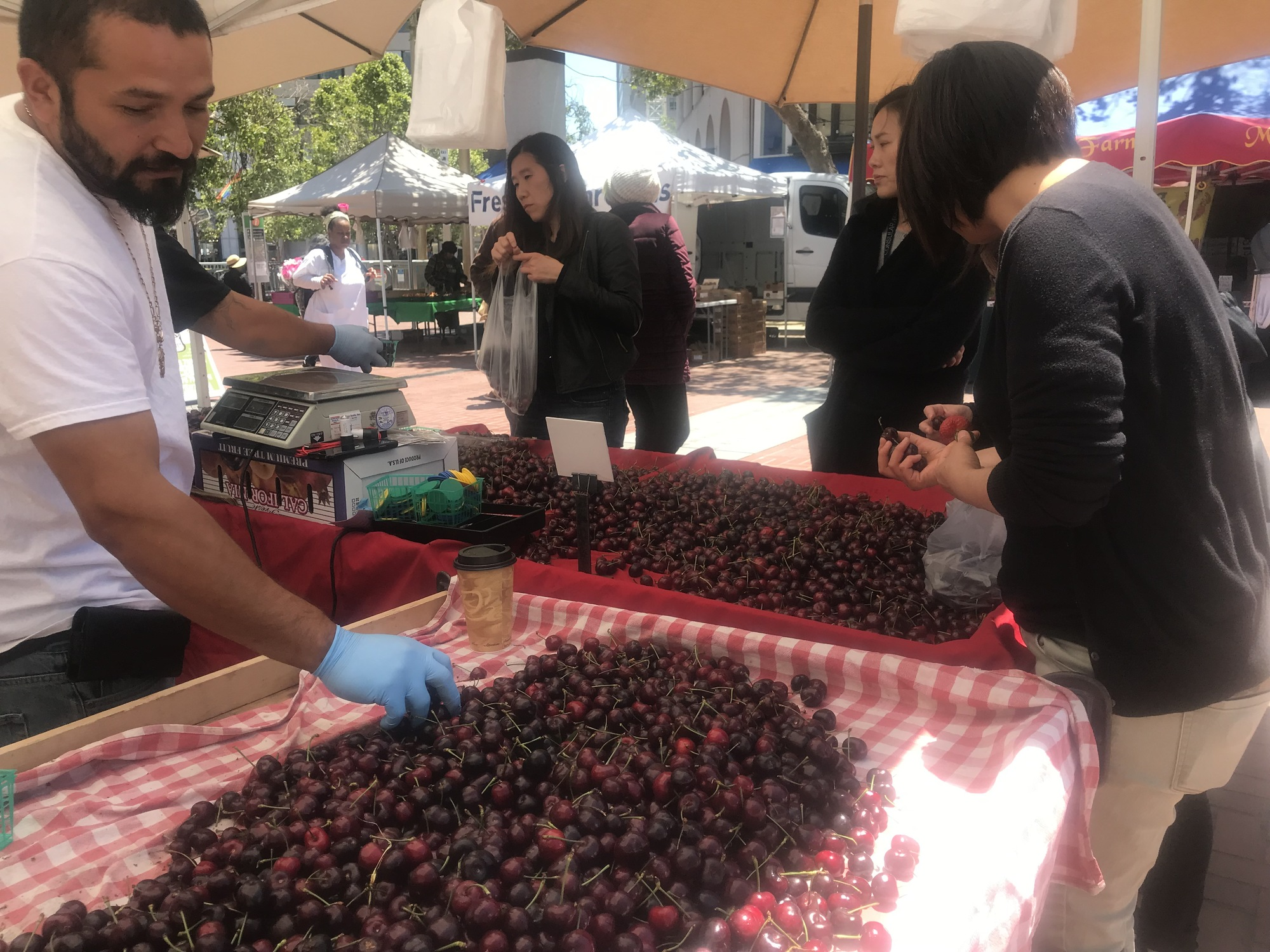 A vendor selling cherries at the market on Friday, June 7.