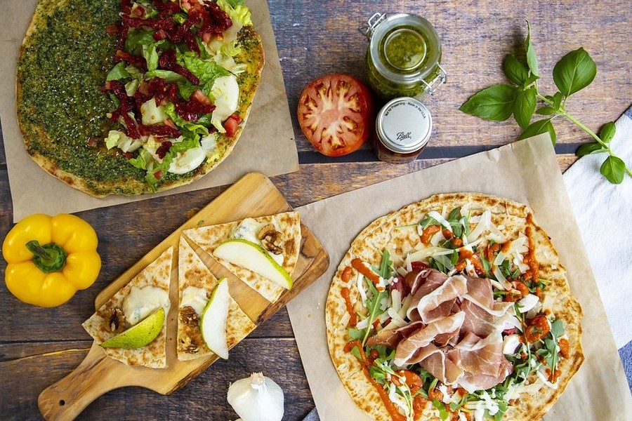 Pizza And Vegetables On Wooden Table