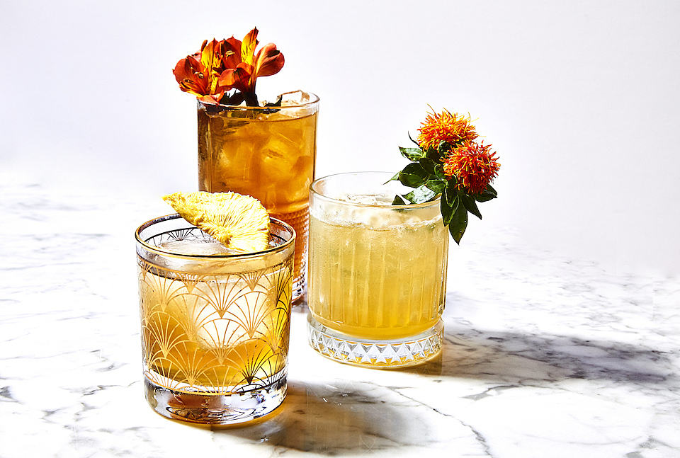 Cocktails are served in vintage-style barware.