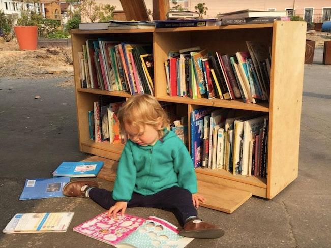 Kid reading playland at 43rd
