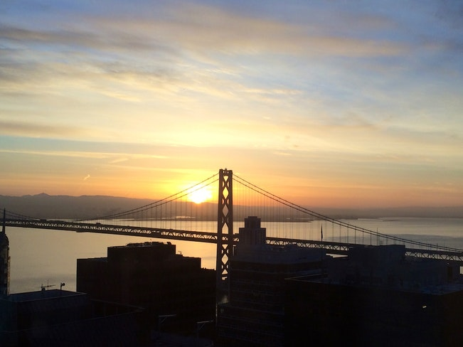 Bay bridge sunrise over soma